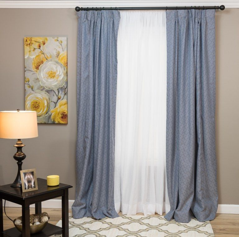 sheer curtains with blue drapes on top