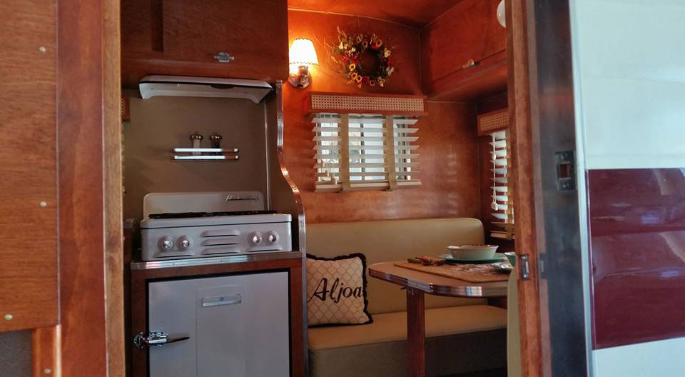 retro trailer with vintage stove and wood blinds