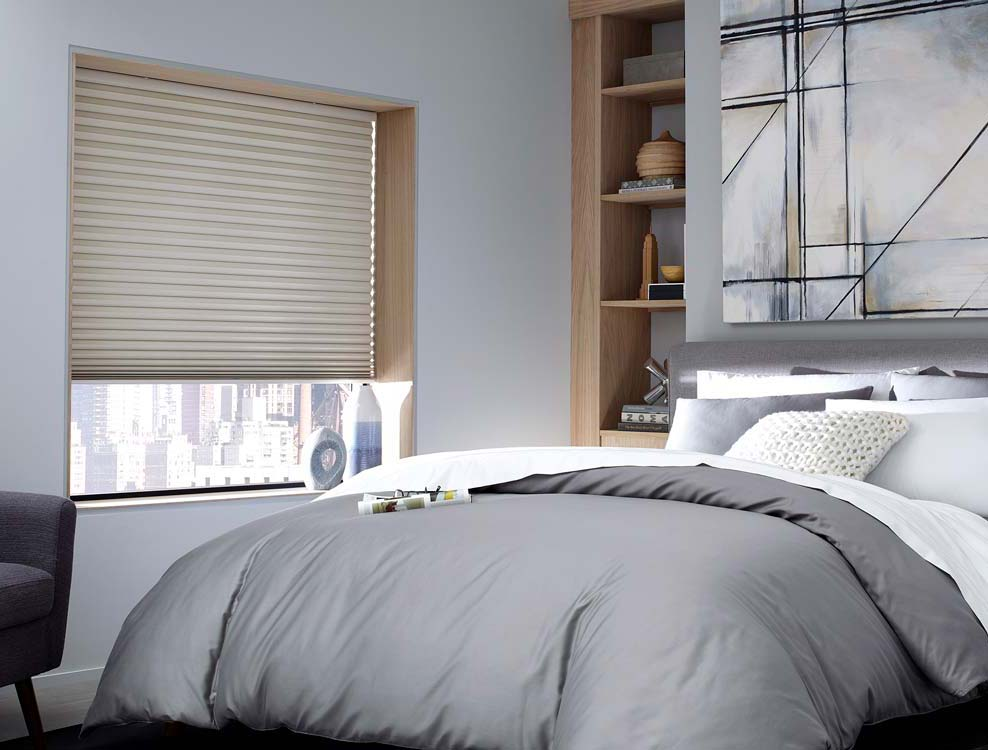 contemporary bedroom with grey comforter and blackout cellular shades