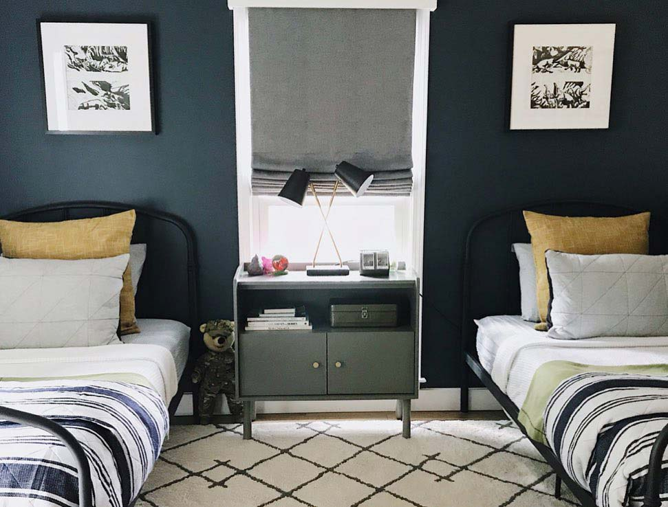 kids bedroom with navy walls and grey blackout roman shades