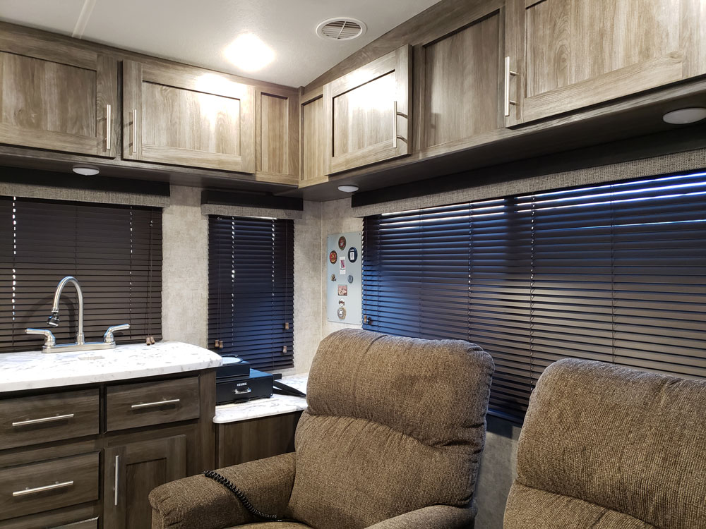 camper interior with brown mini blinds on windows