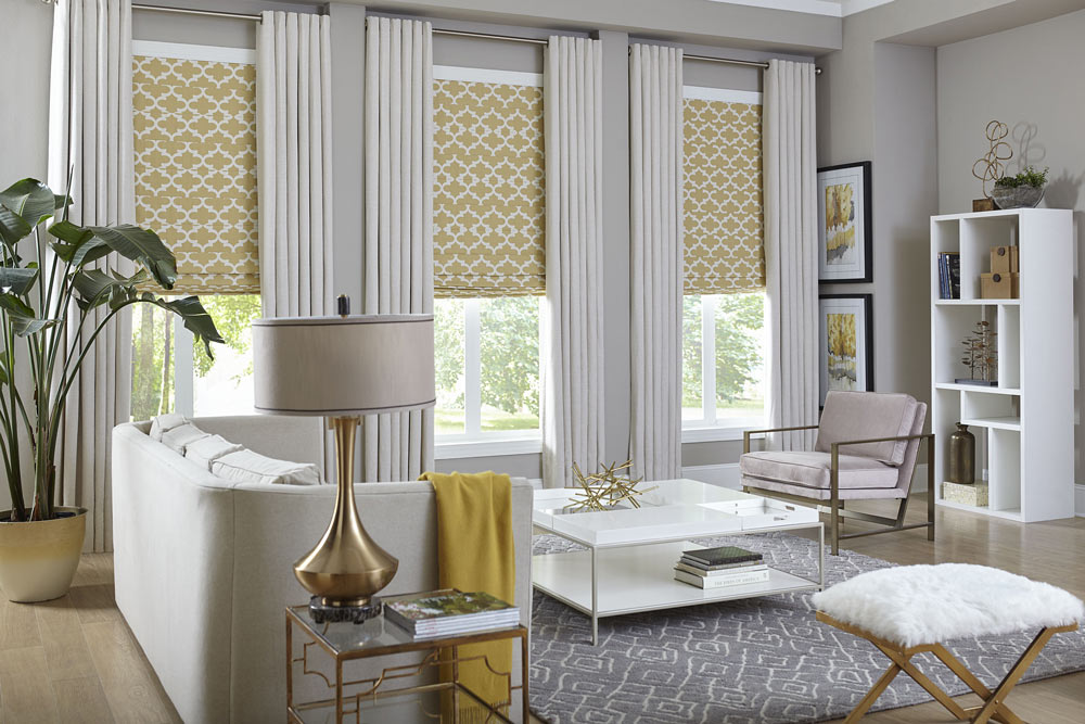 formal living room with yellow shades on windows