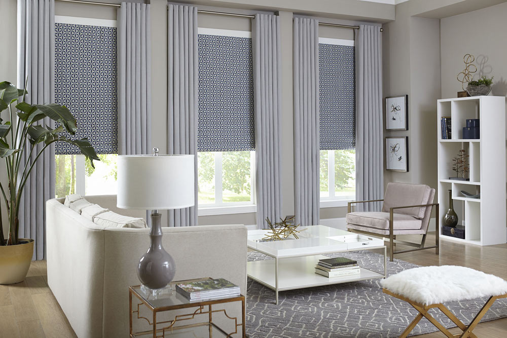 grey living room with blue shades and curtains