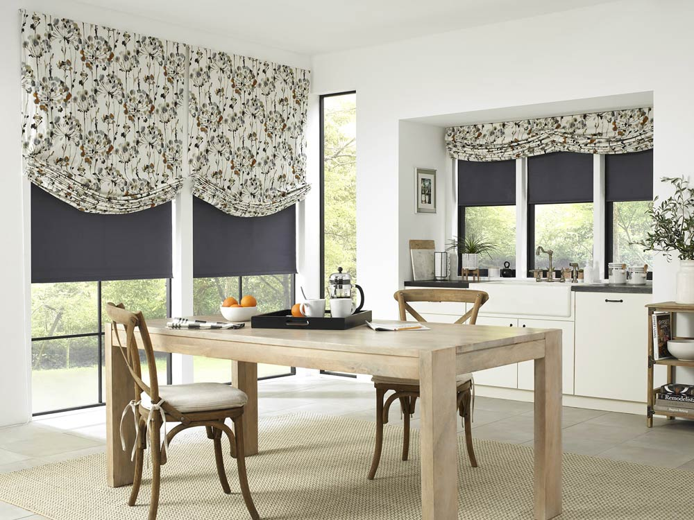 farmhouse kitchen with floral roman shades and blackout roller shades