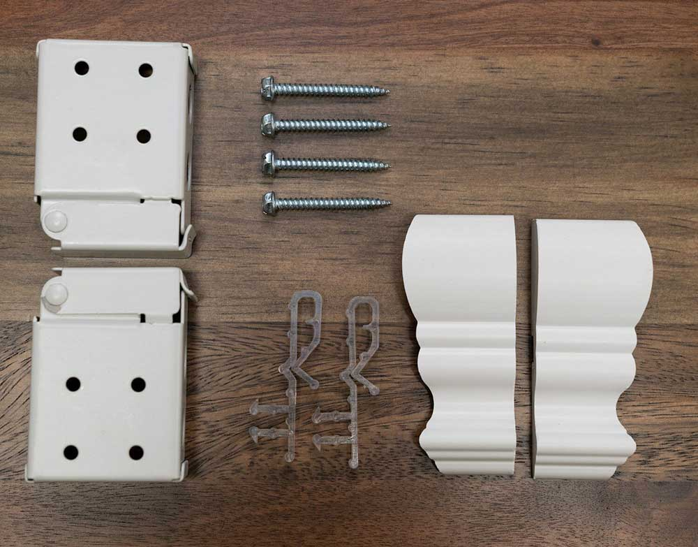 Installation hardware for the Economy Cordless Faux Wood Blind including box brackets, valance clips, screws and valance side returns.